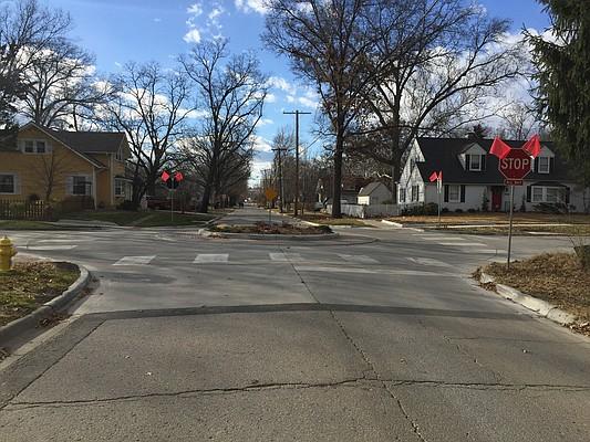 Stop signs at the traffic circle at 18th and Indiana streets.