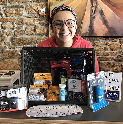 Staff member Sienna Durr presents some of her favorite stocking stuffer options at Ad Astra Running, 734 Massachusetts St.