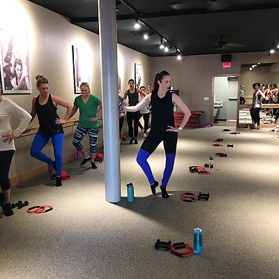 Carrie Barton-Skinner instructs a class at Pure Barre Lawrence, 4821 W. Sixth St. Suite L.