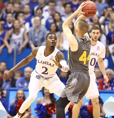 Kansas guard Lagerald Vick (2) looks to swipe the ball from Arizona State guard Kodi Justice (44) during the first half, Sunday, Dec. 10, 2017 at Allen Fieldhouse.