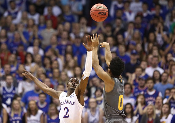 Kansas guard Lagerald Vick (2) defends against a shot from Arizona State guard Tra Holder (0) during the first half, Sunday, Dec. 10, 2017 at Allen Fieldhouse.