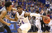 Kansas guard Malik Newman (14) pulls back his dribble while defended by Arizona State guard Tra Holder (0) during the first half, Sunday, Dec. 10, 2017 at Allen Fieldhouse.