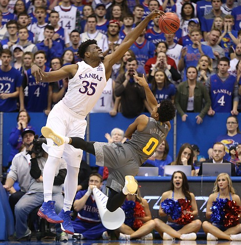 Kansas center Udoka Azubuike (35) sends a shot from Arizona State guard Tra Holder (0) sailing during the second half, Sunday, Dec. 10, 2017 at Allen Fieldhouse.
