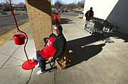 Salvation Army bell ringer Lisa Branch rings from her post on Tuesday, Dec. 12, 2017 at Dillons, 3000 W. Sixth St. Donations to the Salvation Army are reportedly down for the season.