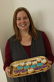 Holiday Cookie Bakeoff finalist Julie Girard is pictured with her Snowflake Crunch Cookies.