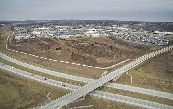 Plans have been filed to build a 700-bedroom student apartment complex on this undeveloped piece of land directly east of Walmart at 33rd and Iowa streets, pictured Thursday, Dec. 14, 2017. The project, which is being called The Collegiate at Lawrence would sit on the 27-acre site, which is bordered by the South Lawrence Trafficway, at left and bottom, and Michigan Street, at right.