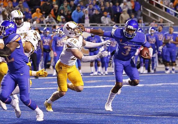 Boise State quarterback Montell Cozart (3) runs the ball against Wyoming safety Andrew Wingard (28) during the second half of an NCAA college football game in Boise, Idaho, Saturday, Oct. 21, 2017. Boise State won 24-14. (AP Photo/Otto Kitsinger)