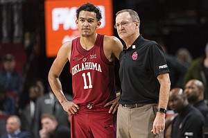 Oklahoma guard Trae Young stands with head coach Lon Kruger during the second half in an NCAA college basketball game against Arkansas during the Phil Knight Invitational Tournament, in Portland, Ore., Thursday, Nov. 23, 2017. (AP Photo/Troy Wayrynen)