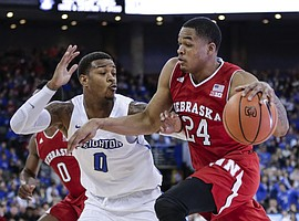 Nebraska's James Palmer Jr. (24) tries to drive around Creighton's Marcus Foster (0) during the first half of an NCAA college basketball game in Omaha, Neb., Saturday, Dec. 9, 2017.