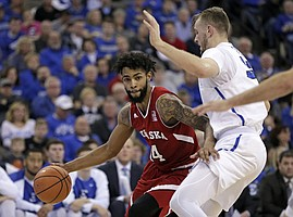Nebraska's Isaac Copeland (14) tries to get around Creighton's Toby Hegner (32) during the first half of an NCAA college basketball game in Omaha, Neb., Saturday, Dec. 9, 2017.