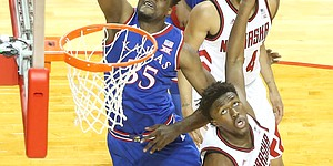 Kansas center Udoka Azubuike (35) puts up a shot over Nebraska center Jordy Tshimanga (32) during the first half, Saturday, Dec. 16, 2017 at Pinnacle Bank Arena in Lincoln, Nebraska.