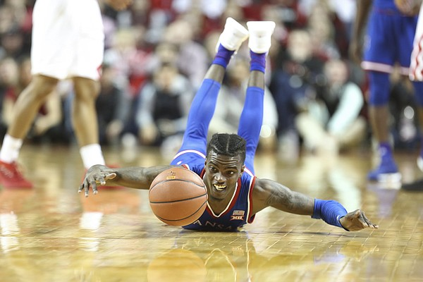 Kansas guard Lagerald Vick (2) lays out for a loose ball during the second half, Saturday, Dec. 16, 2017 at Pinnacle Bank Arena in Lincoln, Nebraska.