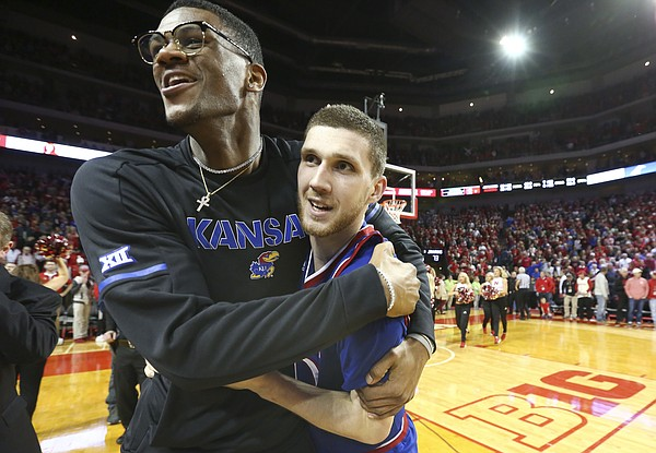 Kansas forward Billy Preston hugs teammate Kansas guard Sviatoslav Mykhailiuk after the Jayhawks' 73-72 win over Nebraska, Saturday, Dec. 16, 2017 at Pinnacle Bank Arena in Lincoln, Nebraska. Mykhailiuk hit a three pointer to give the Jayhawks a one-point lead with seconds remaining.