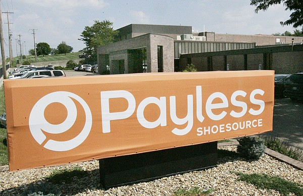 This file photo from August 2006 shows the sign at the entrance of Payless Shoesource, Inc., headquarters in Topeka, Kan. (AP Photo/Orlin Wagner)