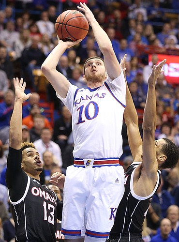 Kansas guard Sviatoslav Mykhailiuk (10) elevates for a shot over Omaha guard Daniel Norl (13) and Omaha guard Zach Jackson during the first half on Monday, Dec. 18, 2017 at Allen Fieldhouse.
