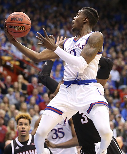 Kansas guard Lagerald Vick (2) swoops in for a shot during the first half on Monday, Dec. 18, 2017 at Allen Fieldhouse.