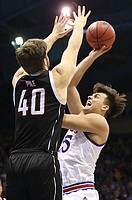 Kansas forward James Sosinski (55) puts up a shot against Omaha forward Matt Pile (40) during the second half on Monday, Dec. 18, 2017 at Allen Fieldhouse.