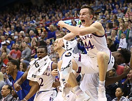 Kansas forward Mitch Lightfoot (44) leaps into the air with excitement after newcomer James Sosinski's first field goal as a Jayhawk late in the second half on Monday, Dec. 18, 2017 at Allen Fieldhouse.