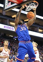 Kansas center Udoka Azubuike (35) delivers a dunk during the first half, Thursday, Dec. 21, 2017 at Golden 1 Center in Sacramento, California.