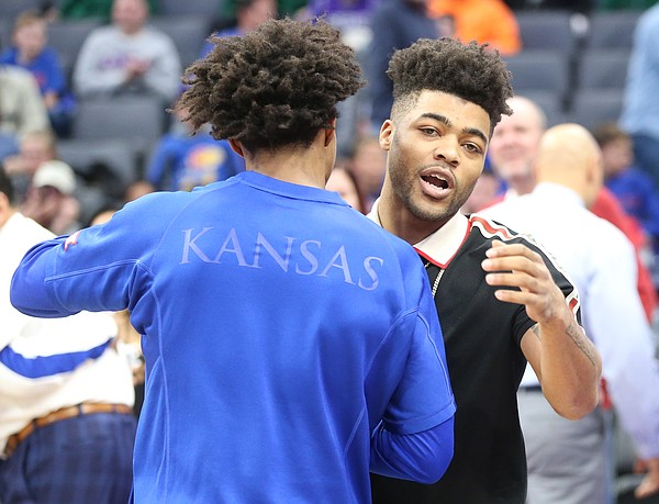 Kansas great and Sacramento Kings guard Frank Mason III gives a pregame hug to his former teammate Kansas guard Devonte' Graham on Thursday, Dec. 21, 2017 at Golden 1 Center in Sacramento, California.