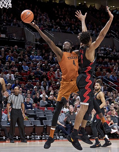 Texas forward Mohamed Bamba, left, shoots over Gonzaga forward Johnathan Williams during the second half of an NCAA college basketball game in the Phil Knight Invitational tournament in Portland, Ore., Sunday, Nov. 26, 2017.