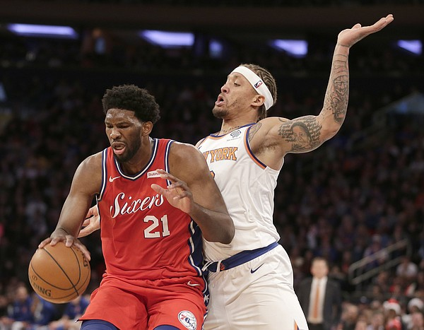 Philadelphia 76ers' Joel Embiid, left, and New York Knicks' Michael Beasley battle for position during the second half of an NBA basketball game, Monday, Dec. 25, 2017, in New York. The 76ers defeated the Knicks 105-98. (AP Photo/Seth Wenig)
