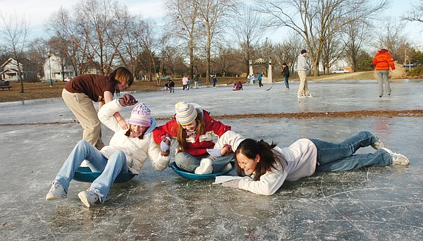 In this file photo from Jan. 17, 2005, from left, Kale Joyce, Abby Hanson, Julia Harris and Chamisa Edmo spend their day off from school at the city's ice-skating rink at Buford M. Watson Jr. Park.