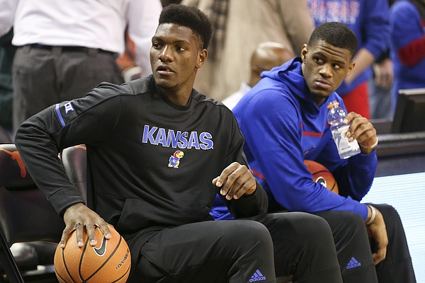Newcomer Silvio DeSousa, left, sits next to teammate Billy Preston, who remains inactive, Friday, Dec. 29, 2017 at Frank Erwin Center in Austin, Texas.