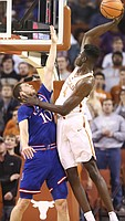 Texas forward Mohamed Bamba (4) pulls back for an attempted dunk over Kansas guard Sviatoslav Mykhailiuk (10) during the first half on Friday, Dec. 29, 2017 at Frank Erwin Center in Austin, Texas.