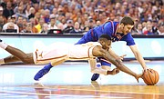 Kansas guard Sviatoslav Mykhailiuk (10) and Texas guard Kerwin Roach II (12) compete for a loose ball during the first half on Friday, Dec. 29, 2017 at Frank Erwin Center in Austin, Texas.