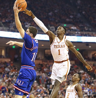 Kansas guard Sviatoslav Mykhailiuk (10) gets off a shot as he is defended by Texas guard Andrew Jones (1) during the first half on Friday, Dec. 29, 2017 at Frank Erwin Center in Austin, Texas.