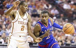 Kansas guard Lagerald Vick (2) drives against Texas guard Matt Coleman (2) during the first half on Friday, Dec. 29, 2017 at Frank Erwin Center in Austin, Texas.