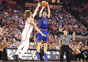 Kansas guard Sviatoslav Mykhailiuk (10) elevates for a three over Texas forward Dylan Osetkowski (21) during the second half on Friday, Dec. 29, 2017 at Frank Erwin Center in Austin, Texas.