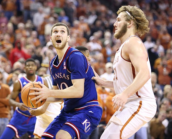 Kansas guard Sviatoslav Mykhailiuk (10) heads to the bucket against Texas forward Dylan Osetkowski (21) during the second half on Friday, Dec. 29, 2017 at Frank Erwin Center in Austin, Texas.