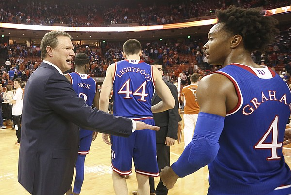 Kansas head coach Bill Self congratulates his players and Kansas guard Devonte' Graham (4) following the Jayhawks' 92-86 win over Texas don Friday, Dec. 29, 2017 at Frank Erwin Center in Austin, Texas.