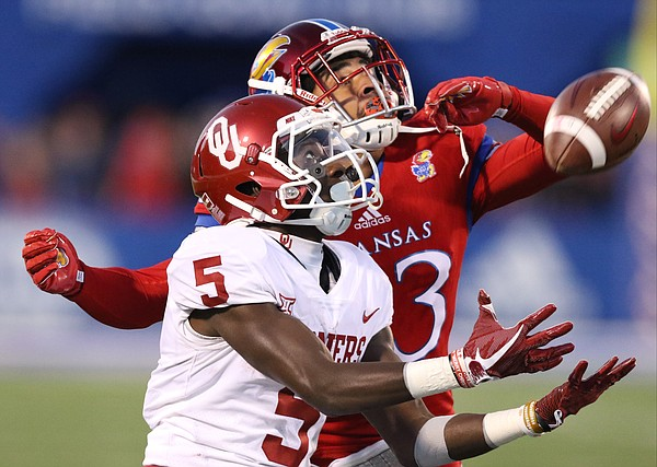 Oklahoma wide receiver Marquise Brown (5) has a deep pass knocked away by Kansas cornerback Hasan Defense (13) during the third quarter on Saturday, Nov. 18, 2017 at Memorial Stadium.