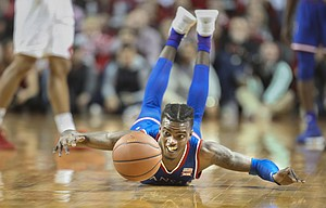 Kansas guard Lagerald Vick (2) dives for a ball during the second half, Saturday, Dec. 16, 2017 at Pinnacle Bank Arena in Lincoln, Nebraska.