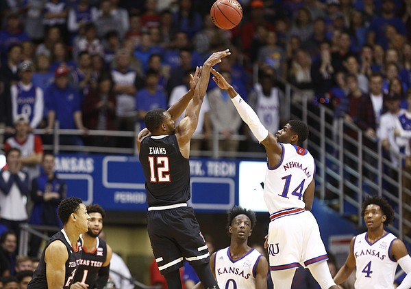 Texas Tech guard Keenan Evans (12) puts up a three over Kansas guard Malik Newman (14) during the first half, Tuesday, Jan. 2, 2018 at Allen Fieldhouse.