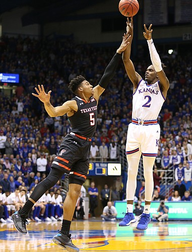 Kansas guard Lagerald Vick (2) puts up a three over Texas Tech guard Justin Gray (5) during the first half, Tuesday, Jan. 2, 2018 at Allen Fieldhouse.