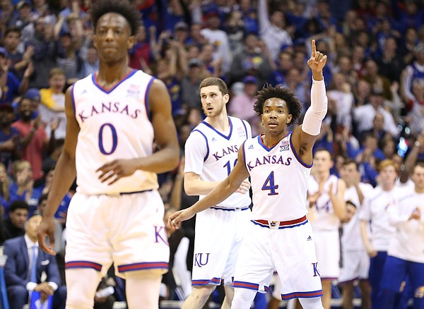 Kansas guard Devonte' Graham (4) signals to his teammates after a bucket during the first half, Tuesday, Jan. 2, 2018 at Allen Fieldhouse.