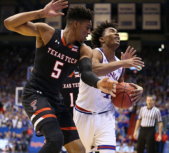 Kansas guard Devonte' Graham (4) is hounded by Texas Tech guard Justin Gray (5) during the first half, Tuesday, Jan. 2, 2018 at Allen Fieldhouse.