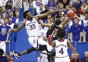 Kansas center Udoka Azubuike (35) fouls Texas Tech guard Keenan Evans (12) on the shot during the second half, Tuesday, Jan. 2, 2018 at Allen Fieldhouse.