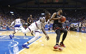 Kansas guard Lagerald Vick (2) can't block an inbound pass to Texas Tech guard Niem Stevenson (10) during the second half, Tuesday, Jan. 2, 2018 at Allen Fieldhouse.