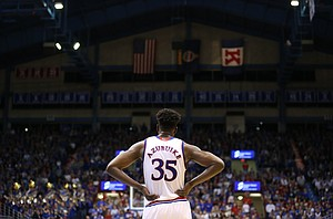Kansas center Udoka Azubuike (35) watches in the second half as the Jayhawks return to action after a timeout in the second half, Tuesday, Jan. 2, 2018 at Allen Fieldhouse.