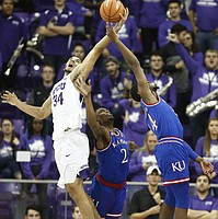 Kansas guard Lagerald Vick (2) and Kansas guard Malik Newman (14) compete for a rebound with TCU guard Kenrich Williams (34) during the first half, Saturday, Jan. 6, 2018 at Schollmaier Arena.