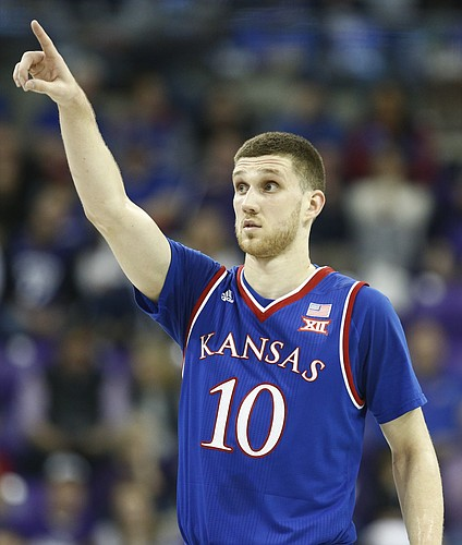 Kansas guard Sviatoslav Mykhailiuk (10) directs his teammates during the first half, Saturday, Jan. 6, 2018 at Schollmaier Arena.
