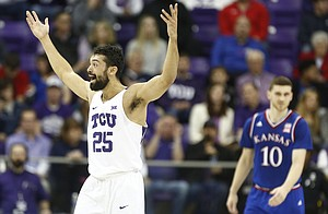 Wanting a foul called on a three point shot, TCU guard Alex Robinson (25) throws his hands in the air during the first half, Saturday, Jan. 6, 2018 at Schollmaier Arena.