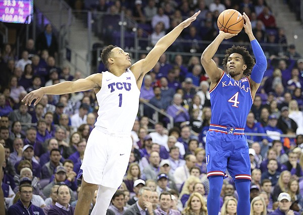 Kansas guard Devonte' Graham (4) pulls up for a three against TCU guard Desmond Bane (1) during the first half, Saturday, Jan. 6, 2018 at Schollmaier Arena.