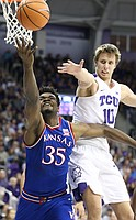 Kansas center Udoka Azubuike (35) fights for a rebound with TCU forward Vladimir Brodziansky (10) during the first half, Saturday, Jan. 6, 2018 at Schollmaier Arena.