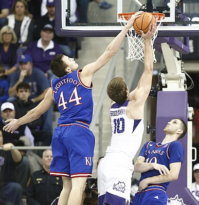 Kansas forward Mitch Lightfoot (44) blocks a shot from TCU forward Vladimir Brodziansky (10) during the second half, Saturday, Jan. 6, 2018 at Schollmaier Arena. At right is Kansas guard Sviatoslav Mykhailiuk (10).